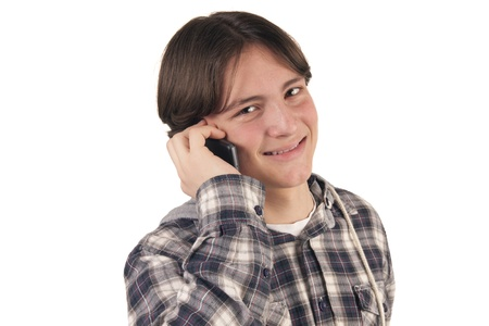 Teenage boy talking on mobile phone isolated on white background photo
