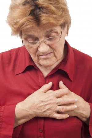 Woman having chest pain isolated on white background  photo