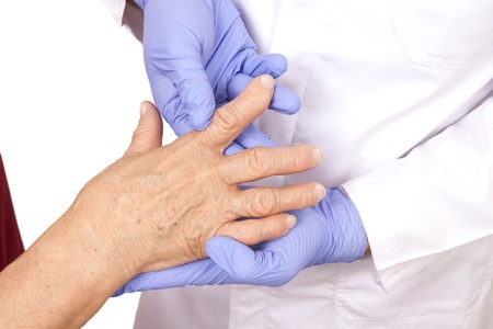 Senior woman with Rheumatoid arthritis visit a doctor Isolated on white Standard-Bild