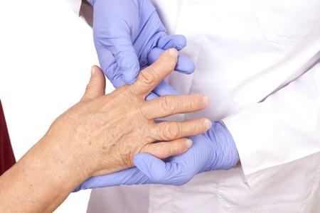rheumatoid: Senior woman with Rheumatoid arthritis visit a doctor Isolated on white Stock Photo