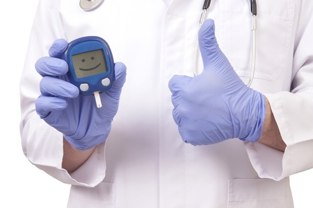 Doctor holding blood sugar meter and showing OK sign. Isolated on white
