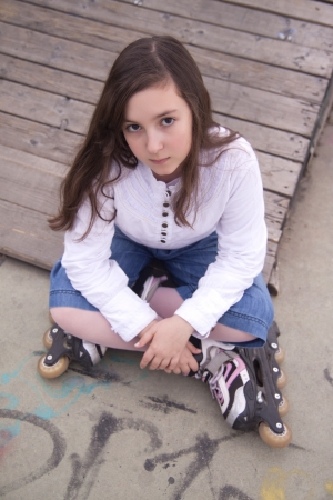 Portrait of beautiful girl with skates in the park photo