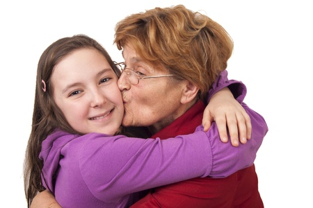 Grandmother kissing granddaughter Isolated on white background photo