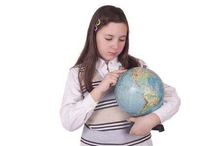 School girl holding a globe isolated on white background photo