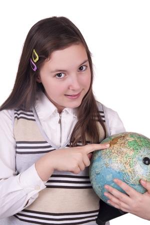 Happy school girl holding globe isolated on white background photo