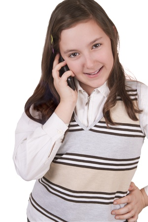 Beautiful school girl talking on mobile phone isolated on white background photo