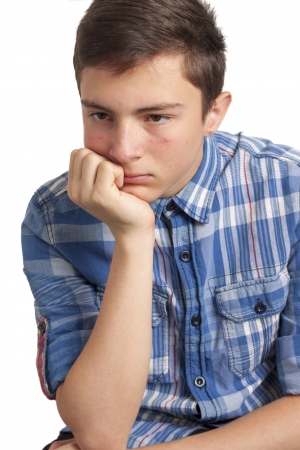 Teenage boy with acne problems Isolated on white background