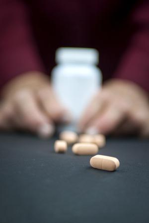 rheumatoid: Hands Of Woman Deformed From Rheumatoid Arthritis holding pills Stock Photo