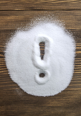 Exclamation mark written on a heap of salt - anti hypertension campaign Stock fotó