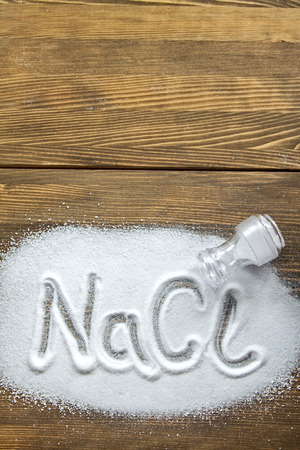 NaCl written on a heap of salt - Sodium Chloride Stock fotó