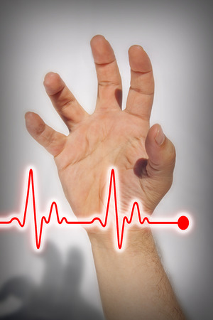 heartattack: Hand with red heartbeat line expressing heart attack- Medical concept