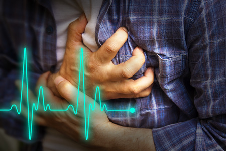 heart disease: Men in blue shirt having chest pain - heart attack - heartbeat line