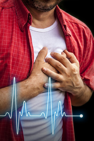 chest pain: Men in red shirt having chest pain - heart attack - heartbeat line