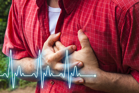 Men in red shirt having chest pain - heart attack - heartbeat line