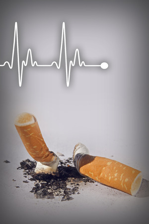 nicotine: Cigarette butts and heartbeat line expressing health hazard - Anti smoking concept