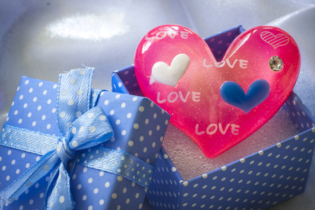 Blue present box with pink heart of glass. For male photo