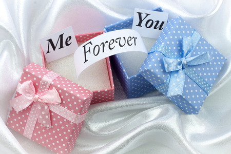 Present boxes with message. For female and male photo