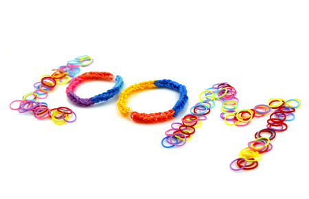 Rainbow loom bracelet. Loom. Isolated on white background photo