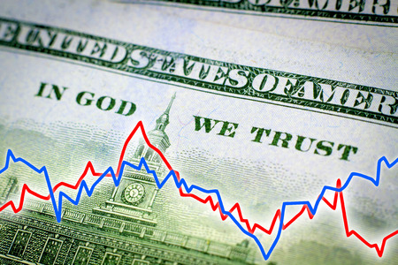 in god we trust: In God We Trust phrase from the dollar banknote and financial graph - Financial concept