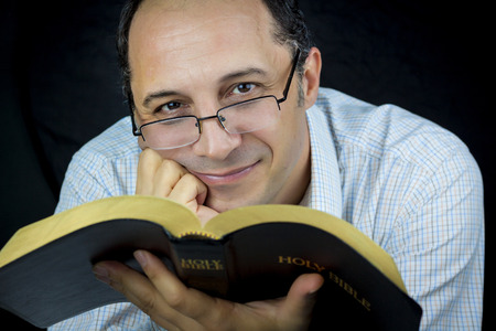 Portrait of a Man Holding Holy Bible photo