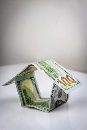 House made of american dollars. Bussines concept photo