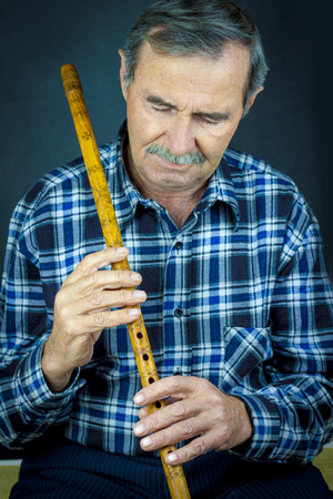 playing folk: Man playing on pipe flute.Traditional folk instruments of Macedonia Europe Stock Photo
