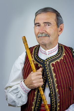 woodwind instrument: Pipe player in traditional clothing