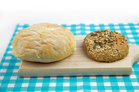 White bread and multigrain bread on table. Imagens