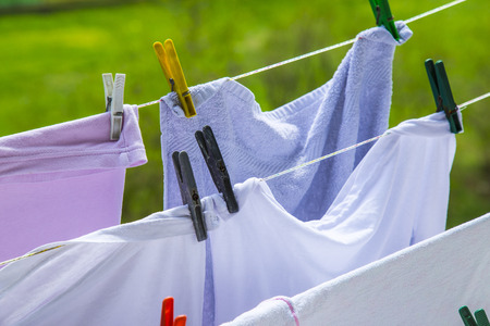 laundry line: Clothes hanging to dry on a laundry line. Blurred background Stock Photo