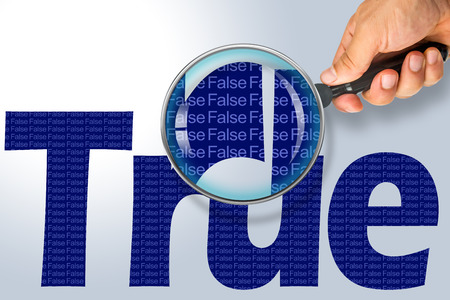 ironic: Human hand holding magnifying glass reading the word TRUE hiding the opposite message FALSE. Dark blue word on a white background. Antonym, hidden reality concept, Hidden message Stock Photo