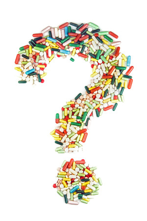 Question mark made of lots of pills and capsules on white background - Hipochondria Concept- Addiction Concept