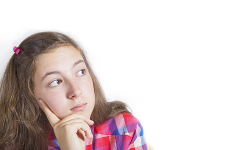 grunge teenager: Portrait of beautiful teenage girl thinking and looking up to empty space. Grunge background Stock Photo