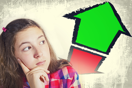 grunge teenager: Portrait of beautiful teenager facing great dilemma. Red and green pointing arrows. Facial expression. Grunge background