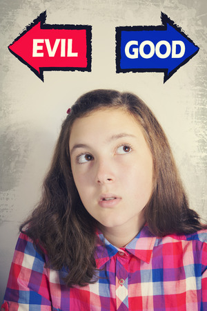good evil: Portrait of beautiful teenage girl thinking what to choose between GOOD and EVIL. Grunge background. Pointing arrows Stock Photo