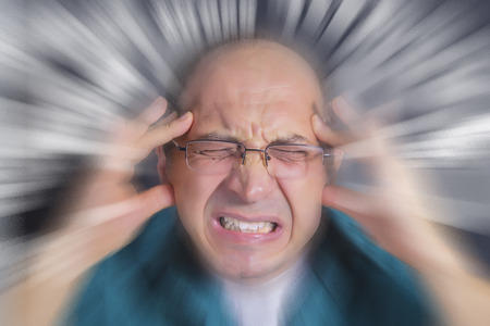 under pressure: Adult man under pressure and severe stress. Stress subjects spinning nervously around mans head