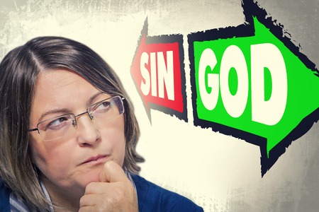 sin: Portrait of woman looking up and thinking what to choose. Sin or God. Religious