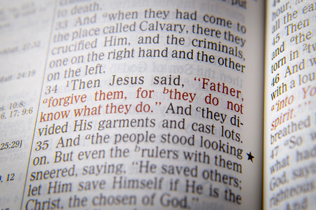 emphasize: Father, forgive them, for they do not know what they do Bible text from Luke 23:34, the Bible. Visual effects to emphasize the message. Macro Stock Photo