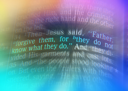 Father, forgive them, for they do not know what they do Bible text from Luke 23:34, the Bible. Visual effects to emphasize the message. Macro Stock Photo