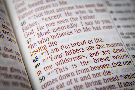 emphasize: I am the bread of life Bible text from John 6:48, the Bible. Visual effects to emphasize the message. Macro
