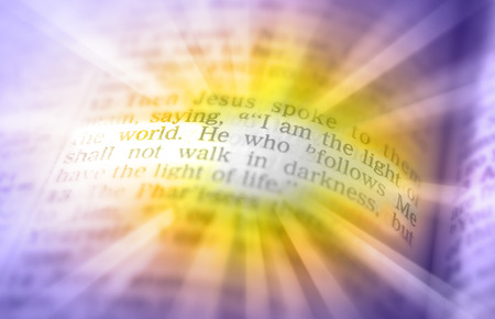 emphasize: I am the light of the world. He who follows Me shall not walk in darkness, but have the light of life. Bible text from John 8:12, the Bible. Visual effects to emphasize the message. Macro Stock Photo