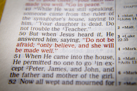 emphasize: ONLY BELIEVE Bible text from Luke 8:50, the Bible. Visual effects to emphasize the message. Macro