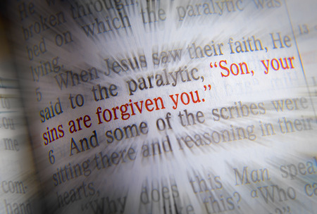 Son, your sins are forgiven you Bible text from Mark 2:5, the Bible. Visual effects to emphasize the message. Macro Stock Photo