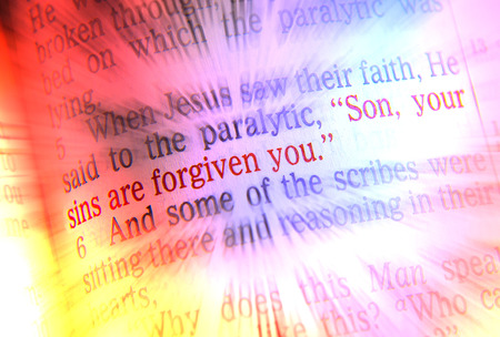 emphasize: Son, your sins are forgiven you Bible text from Mark 2:5, the Bible. Visual effects to emphasize the message. Macro Stock Photo