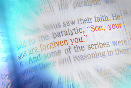 forgiven: Son, your sins are forgiven you Bible text from Mark 2:5, the Bible. Visual effects to emphasize the message. Macro Stock Photo