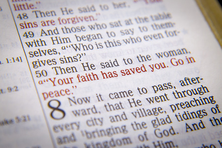 he said: Then He said to the woman, Your faith has saved you. Go in peace. Bible text from Luke 7:50, the Bible. Visual effects to emphasize the message. Macro
