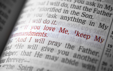 If you love Me, keep My commandments Bible text from John 14:15, the Bible. Visual effects to emphasize the message. Macro