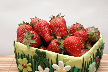 manually: strawberries in a basket from manually