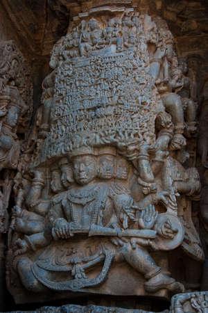 karnataka culture: Ravana, a demon king in Hindu mythology, holding aloft mount Kailash. Stock Photo