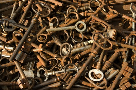 mingled: A box of old rusted keys sold in an antique market Stock Photo