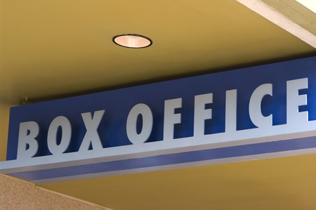 An angled view of an outdoor art deco theater box office sign